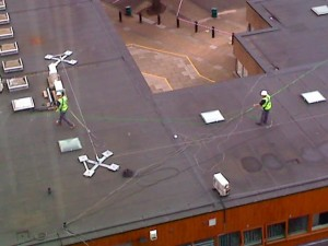 Workmen on the roof at Bedford College